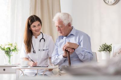 senior patient talking to young nurse